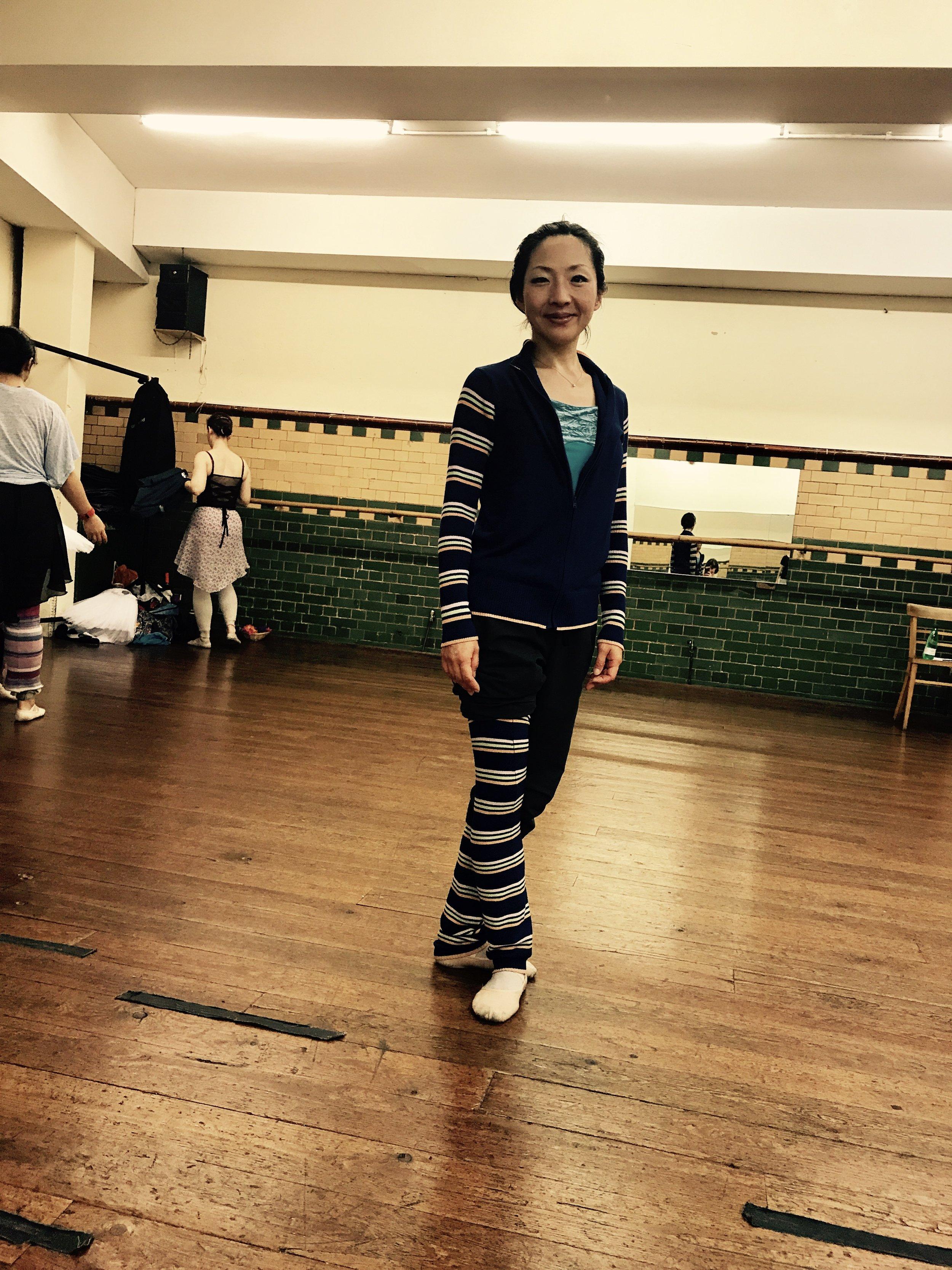 Yoshi wearing matching jacket and leg warmers, in some dynamic stripes.  Jacket and leg warmers -  https://www.chacott-jp.com