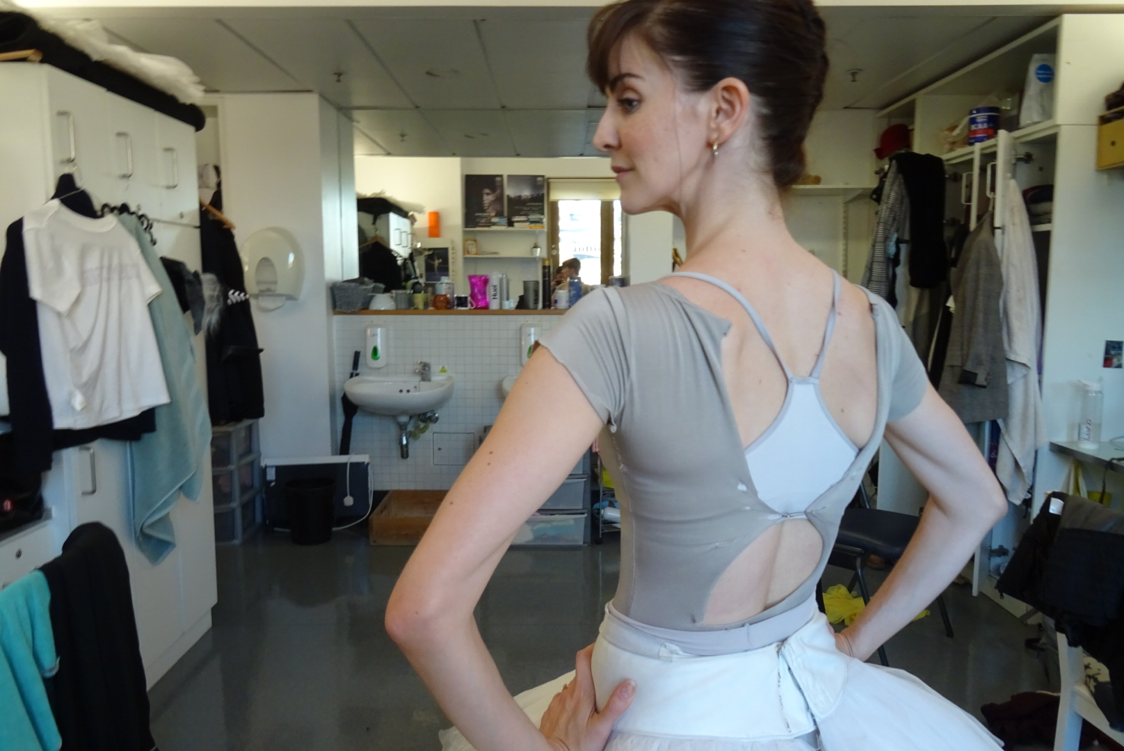 Old leotard held together by a safety pin. Chosen a crop top with an unusual back design.