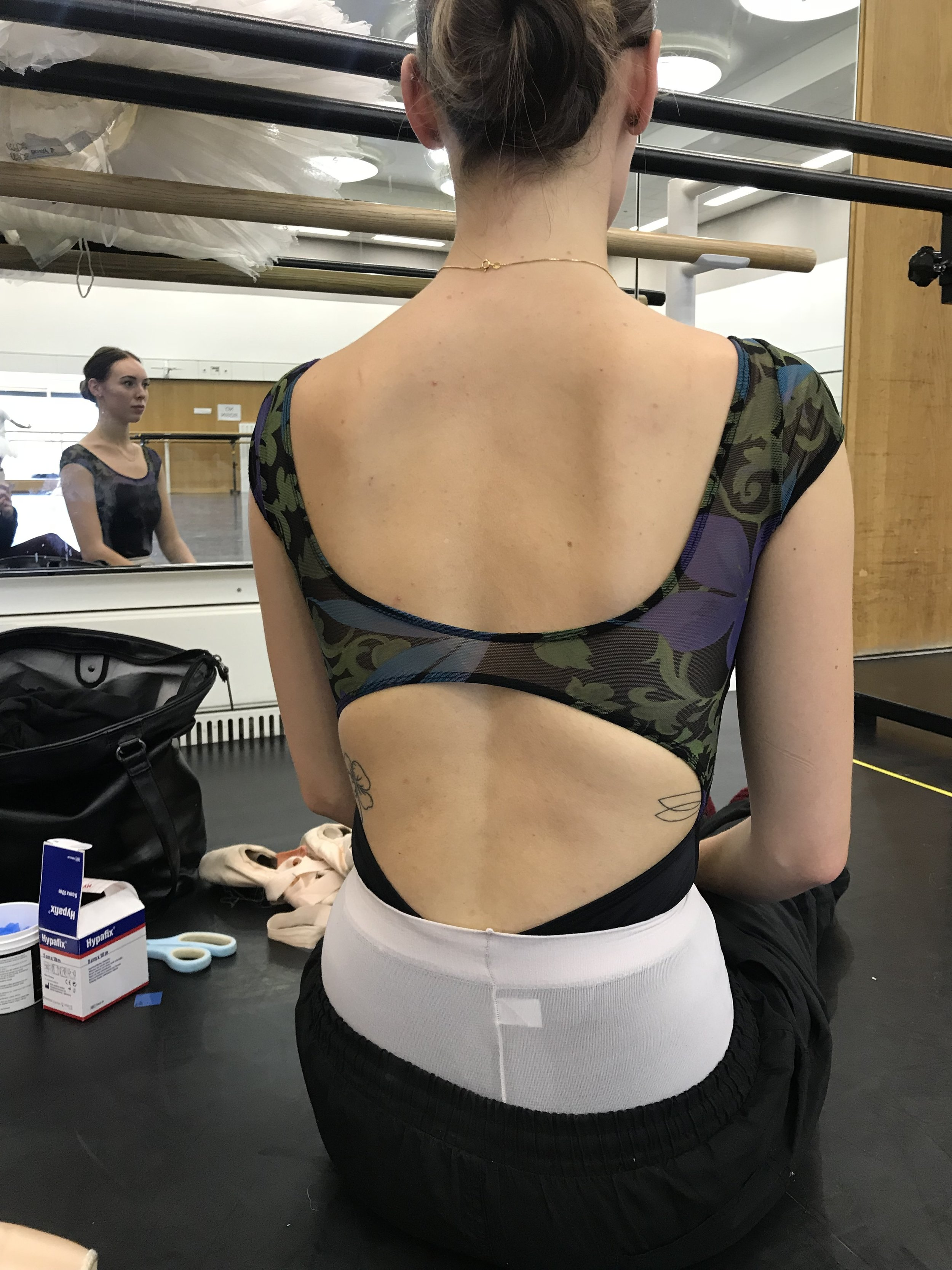 Love how you can see hints of Grace's tattoos with this design of leotard.