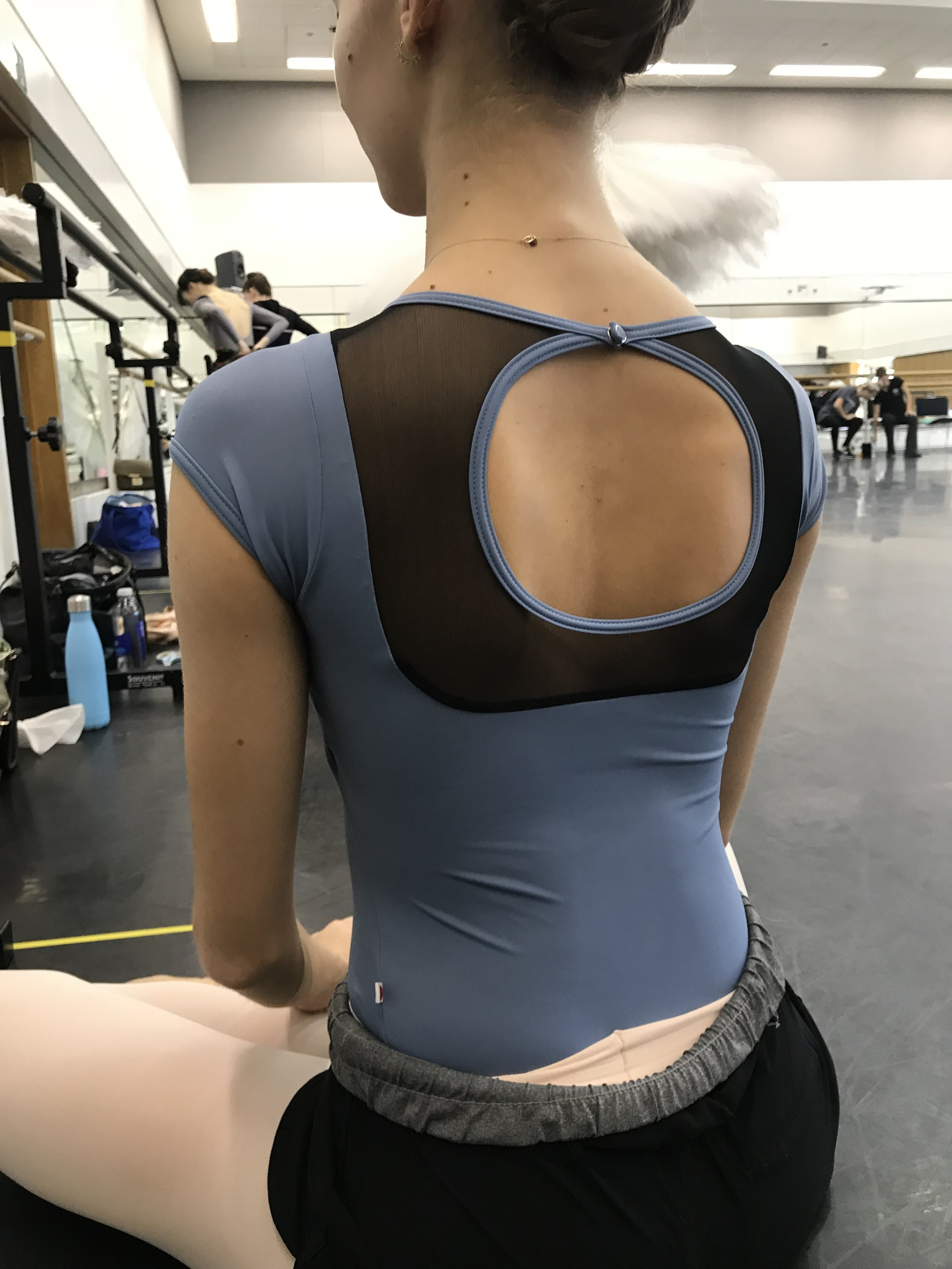 Isabel's leotard has an Art Deco vibe. Very chic.