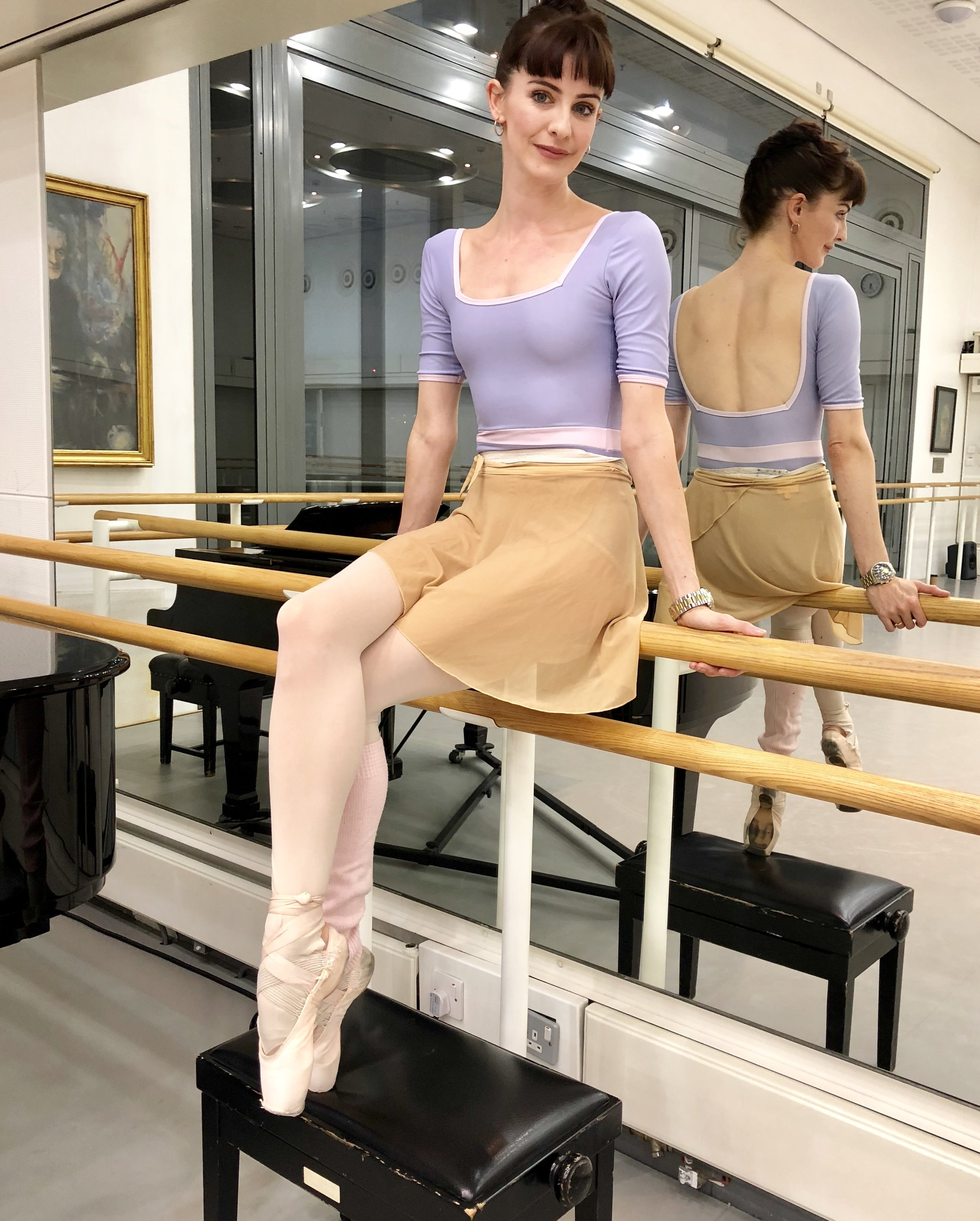 Mixing a violet leotard with a nude skirt and baby-pink calf warmer.      LEOTARD -  q-ballet.net