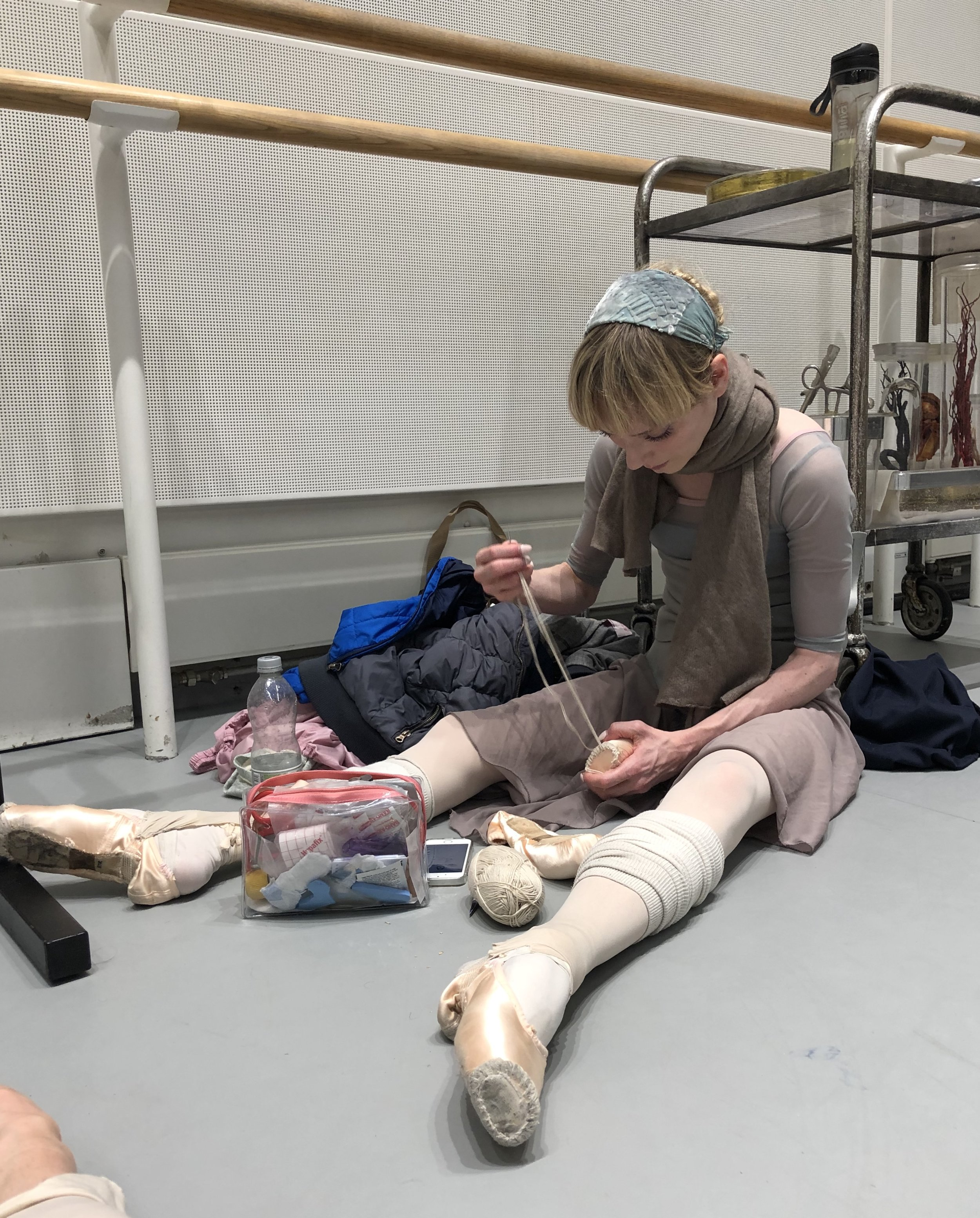 Sarah darning her pointe shoes.
