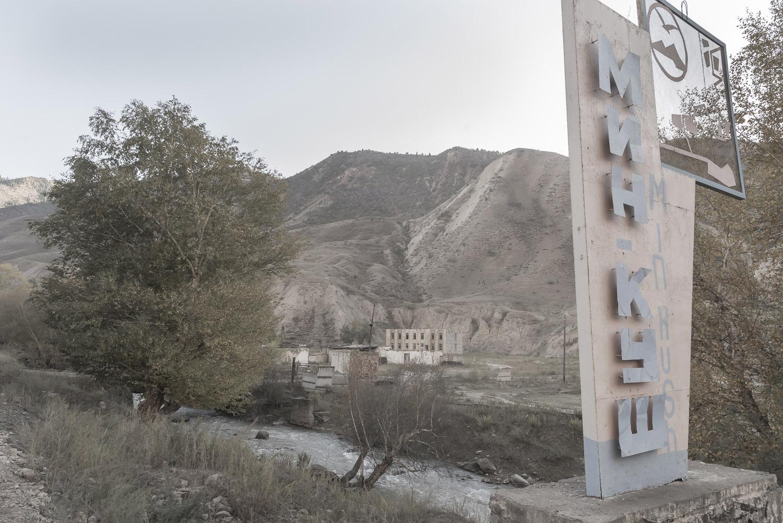 jo-Kearney-videojournalist-video-photographer-cheltenham-minkush-min-kush-Soviet-lada-rusting-Union-industrialwasteland-uranium-mining-ruins-sign-environment-hazardous-waste.jpg