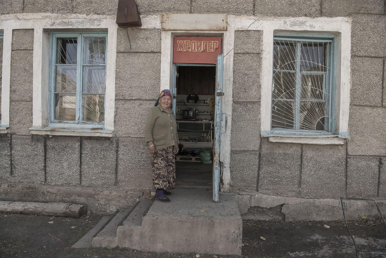 jo-Kearney-videojournalist-photographer-cheltenham-minkush-min-kush-kyrgyzstan-Soviet-Union-oldwoman-kyrgyzwoman-shop-industrialwasteland-uranium-mining-ruins-environment-hazardous-waste.jpg