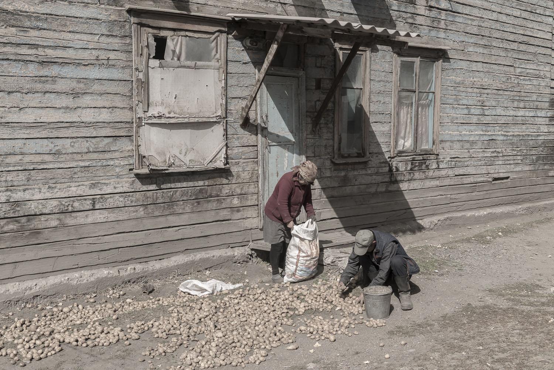 jo-Kearney-videojournalist-photographer-cheltenham-minkush-min-kush-Soviet-Union-potatoes-industrialwasteland-uranium-mining-ruins.jpg