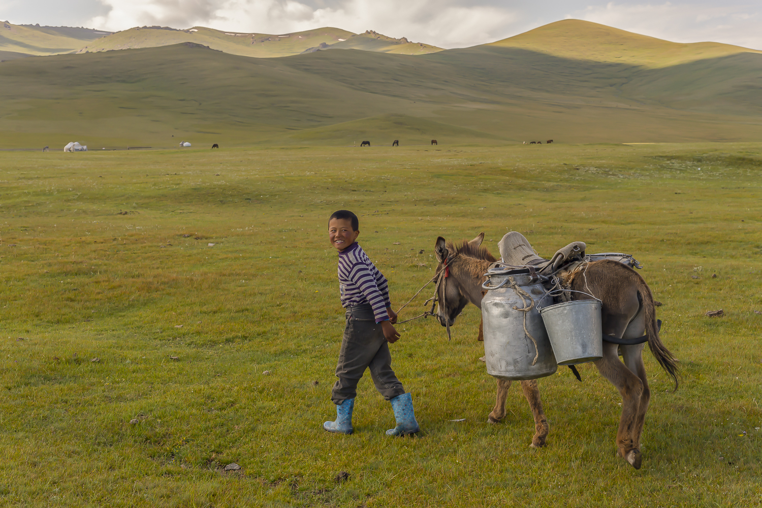 boy-milking-jo-kearney-photography-video-kyrgyzstan-nomads-milking-donkeys-photos-for-sale.jpg