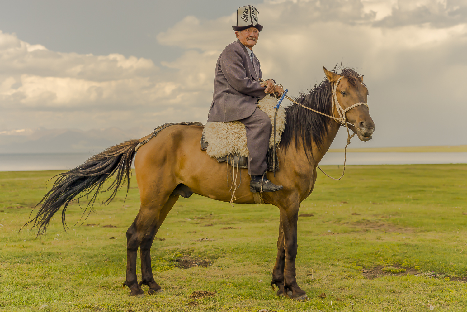 jo-kearney-photography-video-kyrgyzstan-nomads-horse-man-on-horse-traditional-song-kul-horseman.jpg