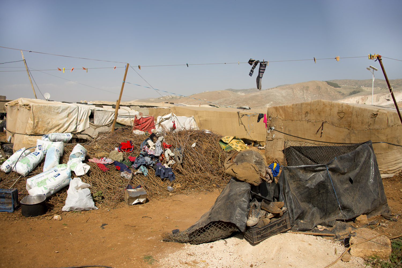 jo-kearney-photography-video-refugees-lebanon-bekaa-valley-syrian-refugees-deitrus-tents-socks.jpg