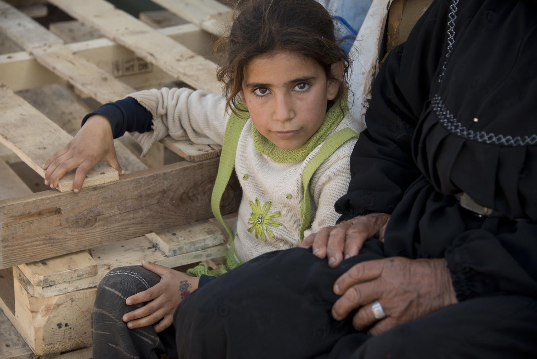 jo-kearney-photography-video-refugees-lebanon-bekaa-valley-syrian-refugees-girl-grandmother.jpg