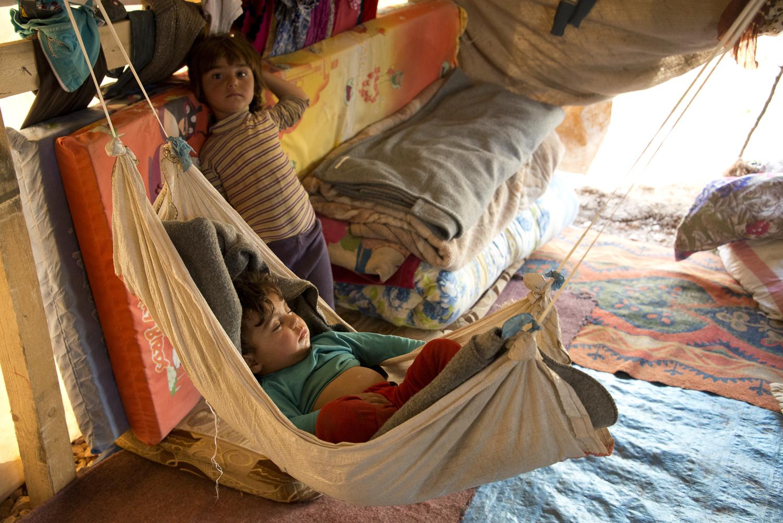 jo-kearney-photography-video-refugees-lebanon-bekaa-valley-syrian-refugees-baby-hammock-tent.jpg