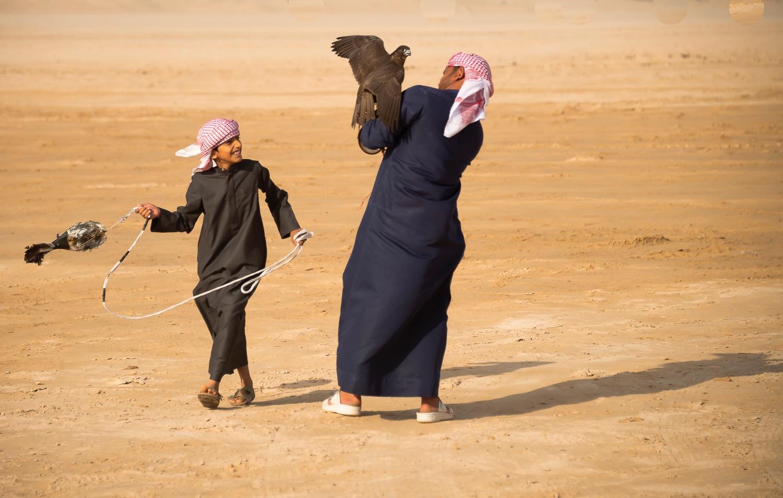jo-kearney-video-photos-photography-travel-portraits-prints-for-sale-falconry-children-UAE-Dubai-desert-falconry-competition.jpg