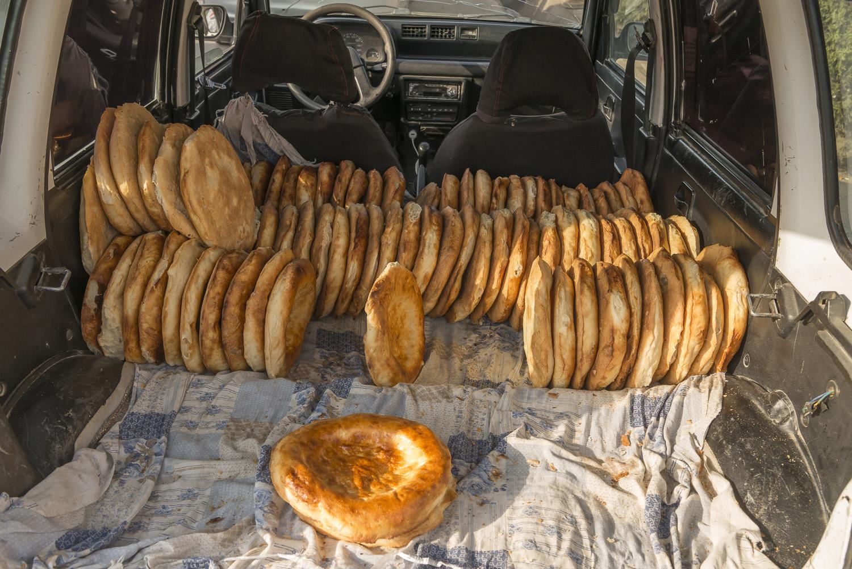 roadside-stalls-market-kyrgyzstan-travel-photography-bread-osh.jpg