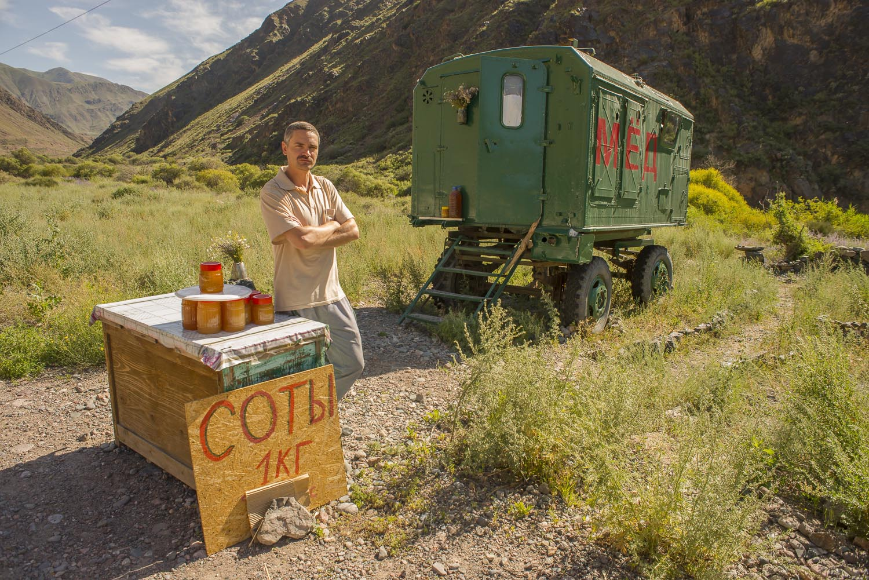 roadside-stalls-market-kyrgyzstan-travel-photography-groceries-honey-for-sale.jpg