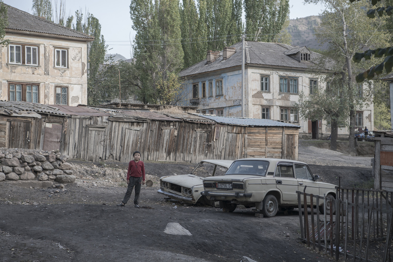 boy-ladas-abandoned-min-kush-soviet-uranium-mining-town-industrial-Russia-Kyrgyzstan-ruins-soviet-sign-jo-kearney-photos-video-photography.jpg