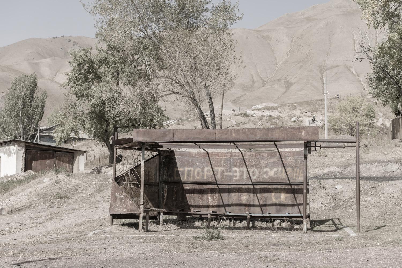 min-kush-soviet-uranium-mining-town-industrial-Russia-Kyrgyzstan-ruins-soviet-sign-jo-kearney-photos-video-photography.bus-shelter-abandonment-rusting-soviet.jpg