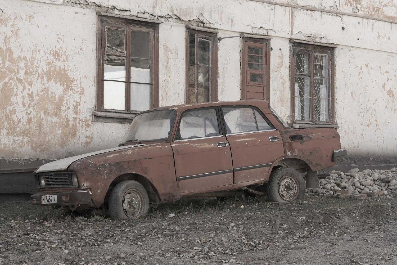 min-kush-soviet-uranium-mining-town-industrial-Russia-Kyrgyzstan-ruins-soviet-sign-jo-kearney-photos-video-photography.lada.abandonment.jpg