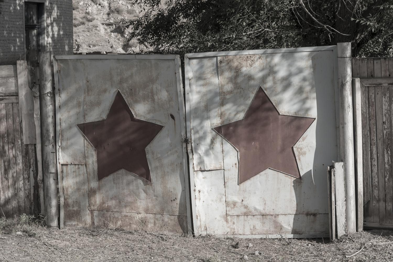 min-kush-soviet-uranium-mining-town-industrial-Russia-Kyrgyzstan-ruins-soviet-sign-jo-kearney-photos-video-photography-red-stars-gates.jpg