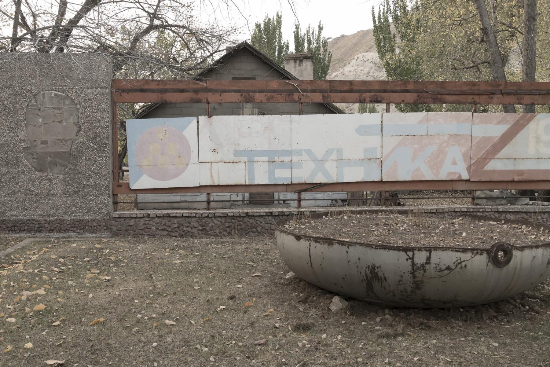min-kush-soviet-uranium-mining-town-industrial-Russia-Kyrgyzstan-ruins-soviet-sign-jo-kearney-photos-video-photography-pen-factory-sign-soviet.jpg
