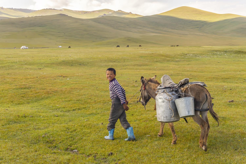 kyrgyzstan-nomads-lake-song-kul-jo-kearney-video-photography-soviet-yurt-family-boy-with-donkey.jpg