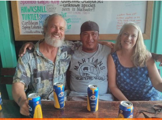This picture is of Nelson sitting between us with cans of Salva Vida (Life Saver) beer on the table in front of us.