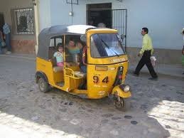 But not this, maybe, I think. It's called a Tuk-Tuk, and I'm itching to drive one!