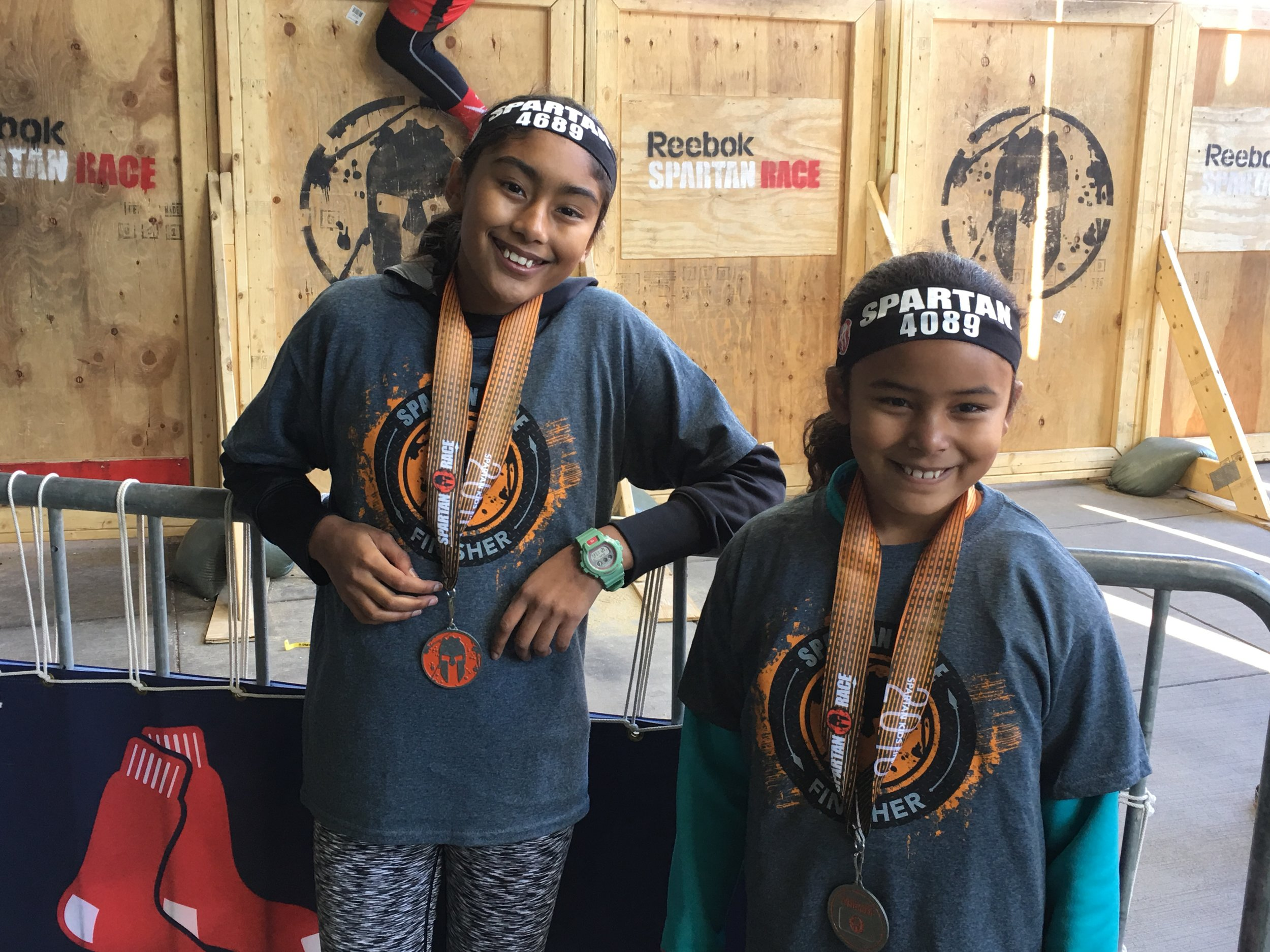 Reimagine Play Team members proud of their finish at the 2016 Spartan Kids Fenway Race