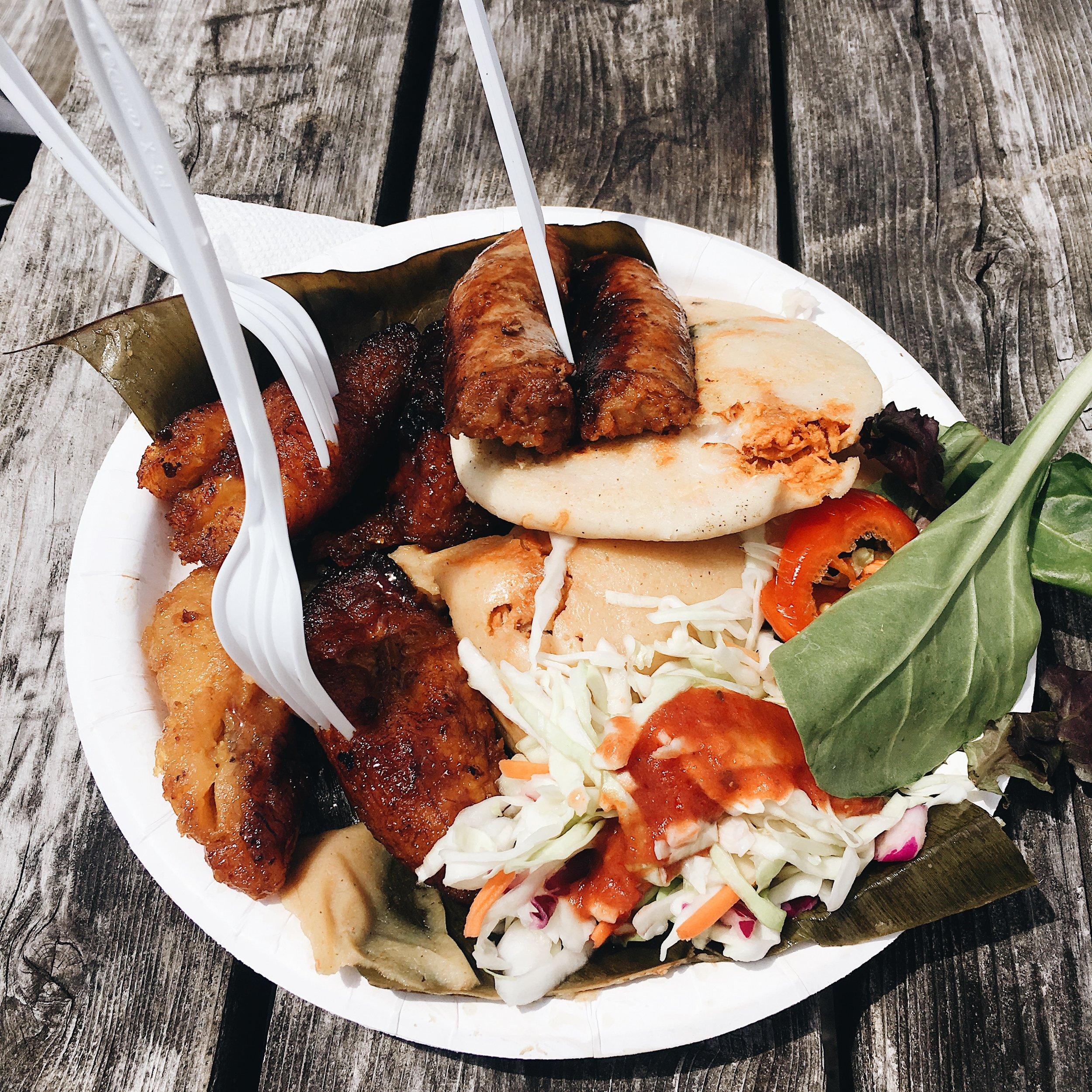 pupusa sampler platter-a salvadoran dish including pork tamale, chicken + cheese pupusa, chorizo, plantains, peppers and coleslaw!