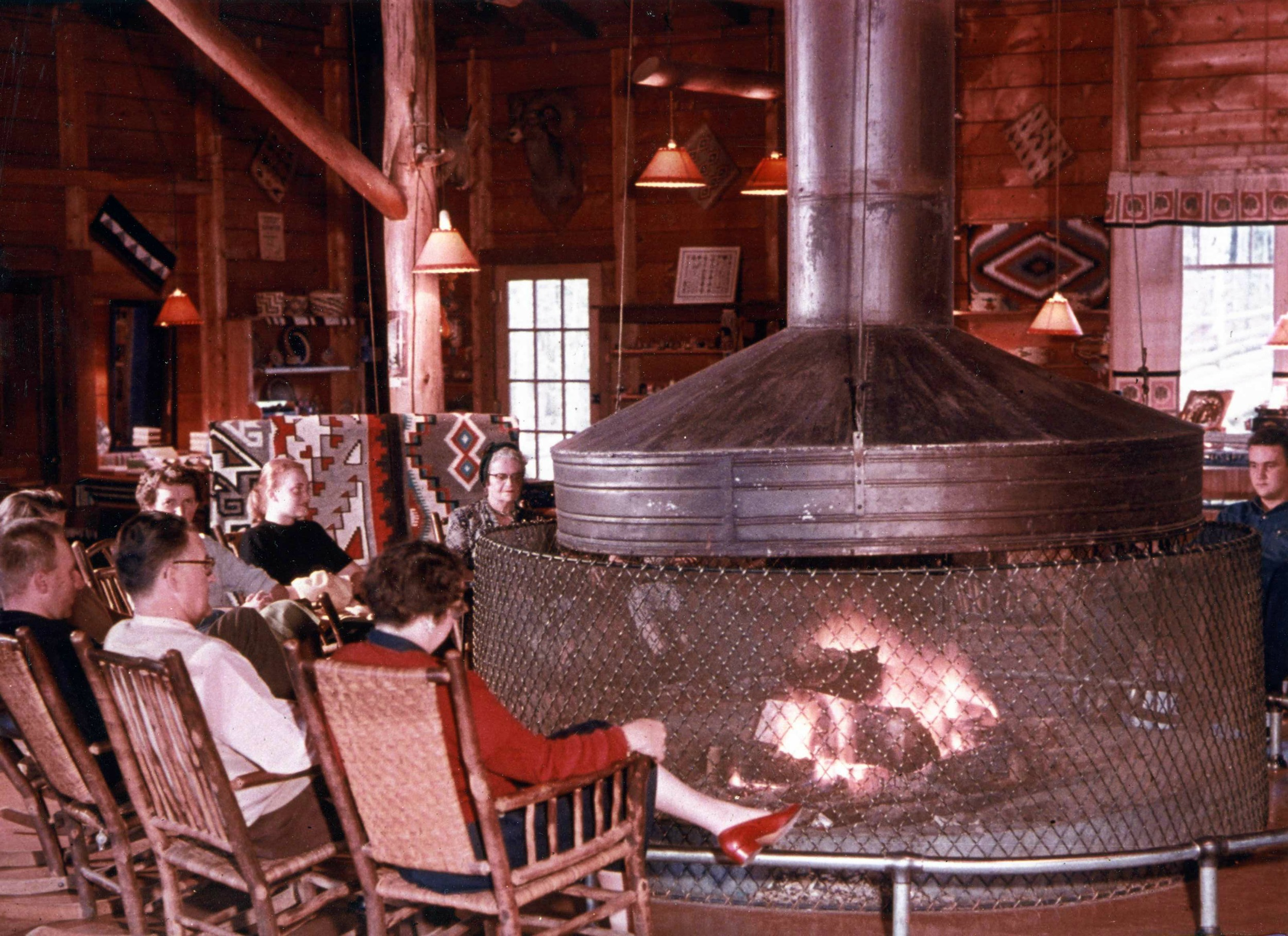 Guests enjoying the lobby fireplace at the Grand Lake Lodge