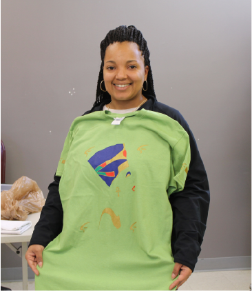 Boys & Girls Club Program Director, Ms. Tasha Burgo, with her Nefertiti Spirit shirt.