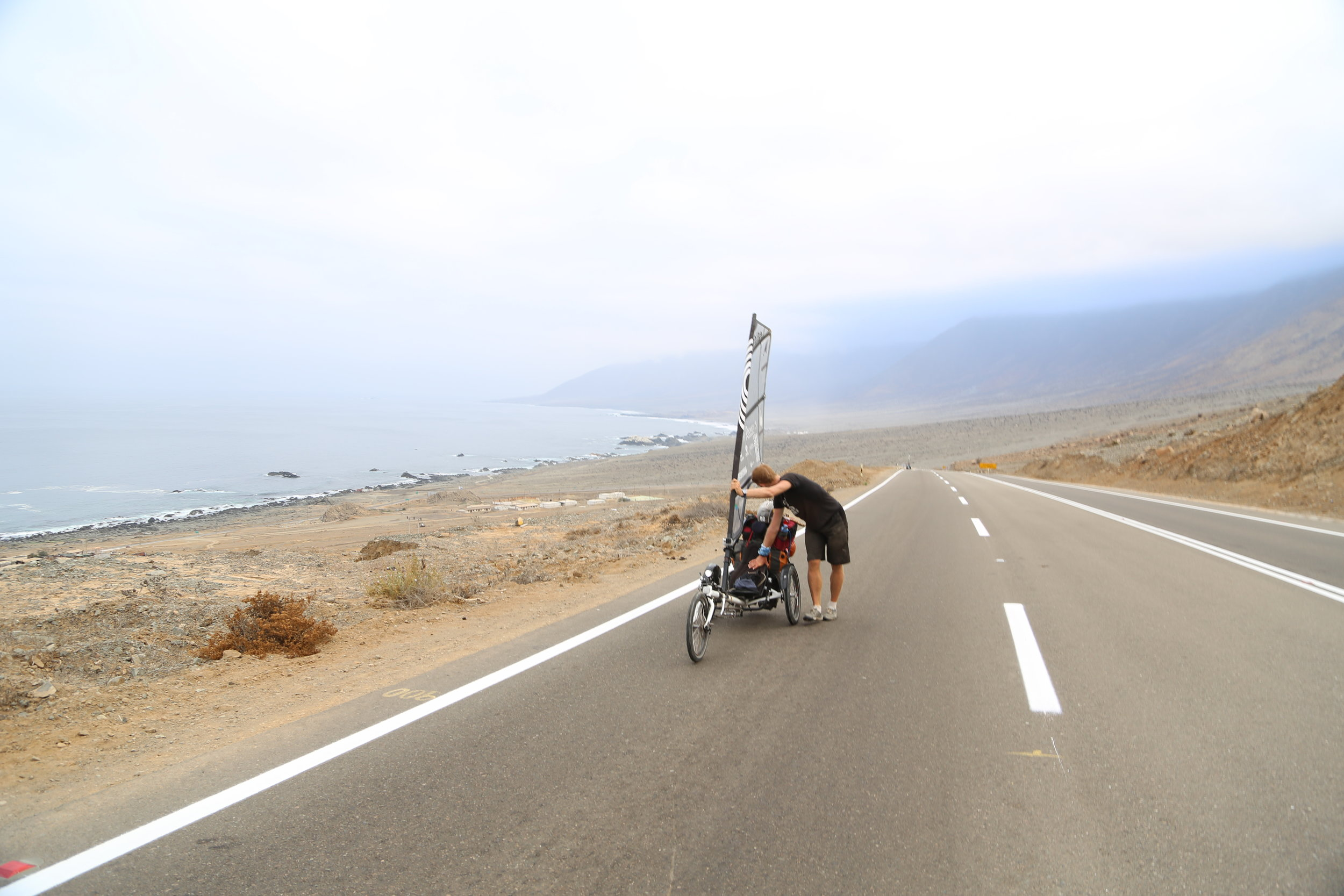 Sometimes you have to get off and push. Rising up from the Pacific on a Chilean desert hill that my Whike wasn't designed for.
