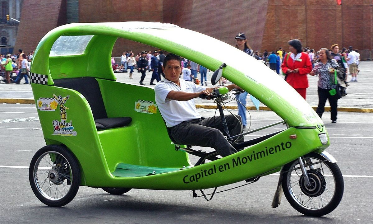 A closed shell bicycle rickshaw. Dave would be happier than this guy.