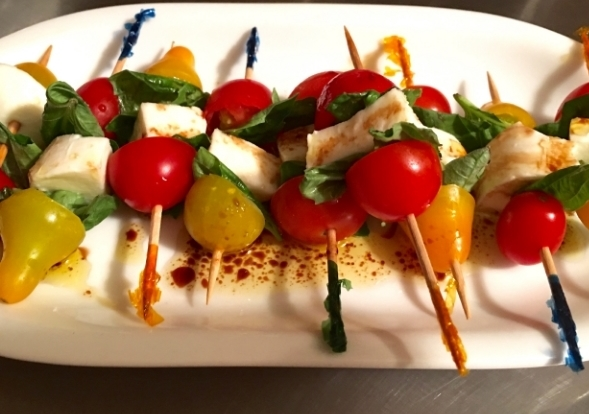 A festive and fun way to serve mini portions of Caprese salad