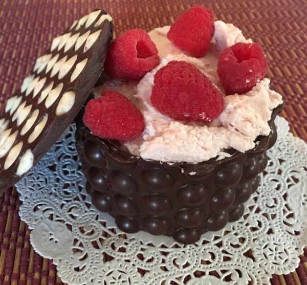 Once you finished those decadent chocolate truffles, you can re-use our chocolate box to serve a refreshingly elegant dessert like this   White Chocolate Raspberry Mousse  . The perfect way to eat this is to break off pieces of the box and dip them in the mousse. Talking about the 'ultimate box recycling'!
