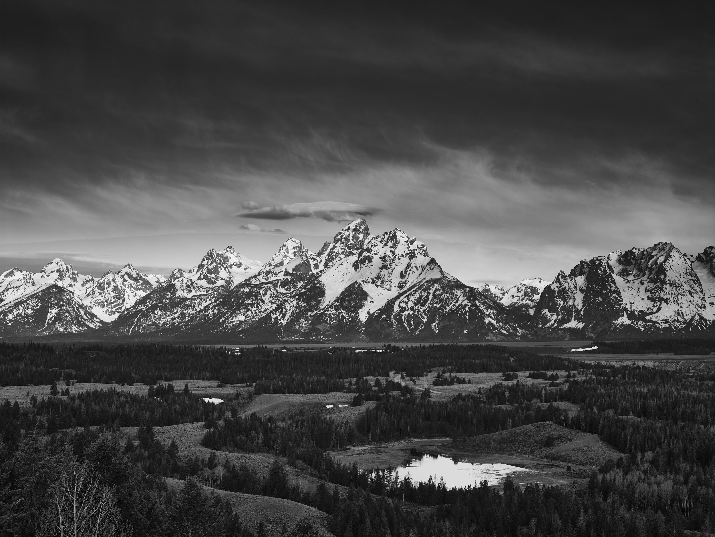 The 3-stop ND filter balances the luminosity of the sky to the terrain almost perfectly and draws the viewer's eye to the mountain range.