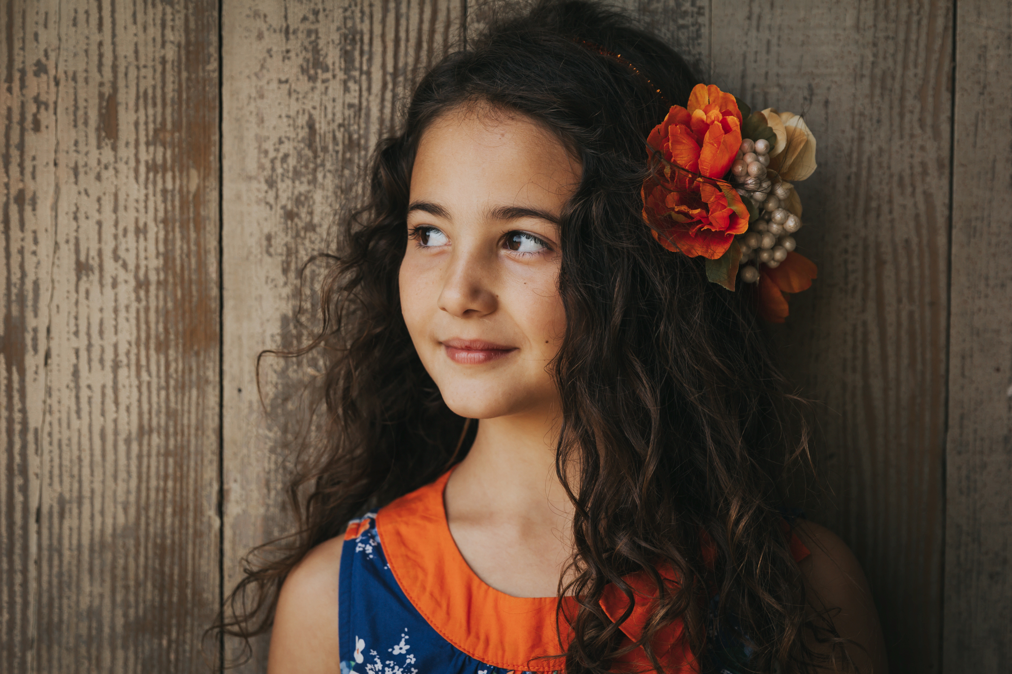Portrait of a stunning little girl with flowers