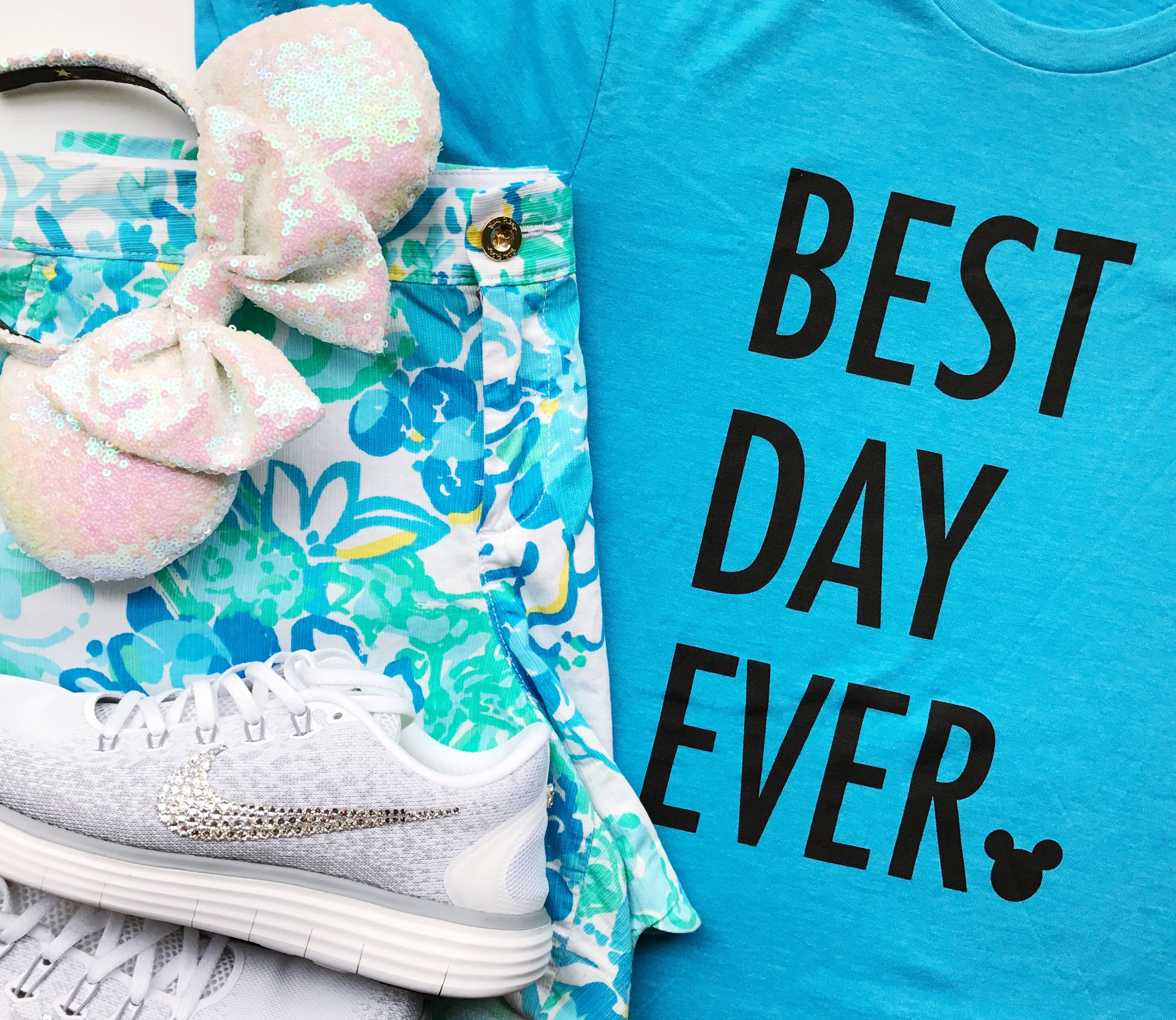 Later that day I changed into yet another Best Day Ever tee from my shop  Happily Ever Tees . These shorts are from  Lilly Pulitzer  and the shoes are from  Bibbidi Bobbidi Bling.  I added the cardigan from the car earlier to this look for dinner at Hollywood Studios.   These are the Unicorn Sequin ears from  Bibbidi Bobbid Brooke .