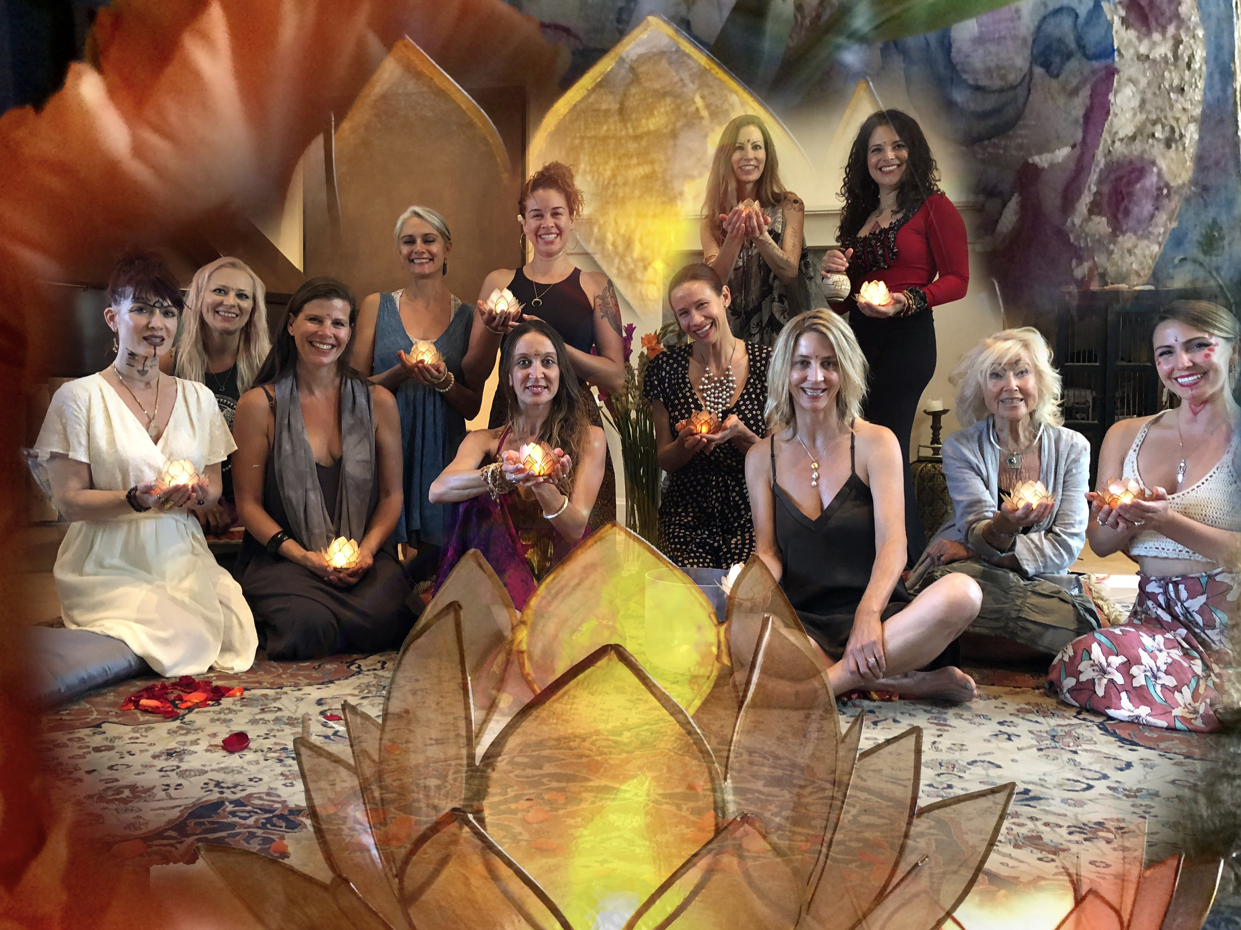 Participants from the initial She is Love Temple day immersion July 2018. They are holding the light and flame of their sacred codes. Some of the creative face paint came from a deep womb ritual.