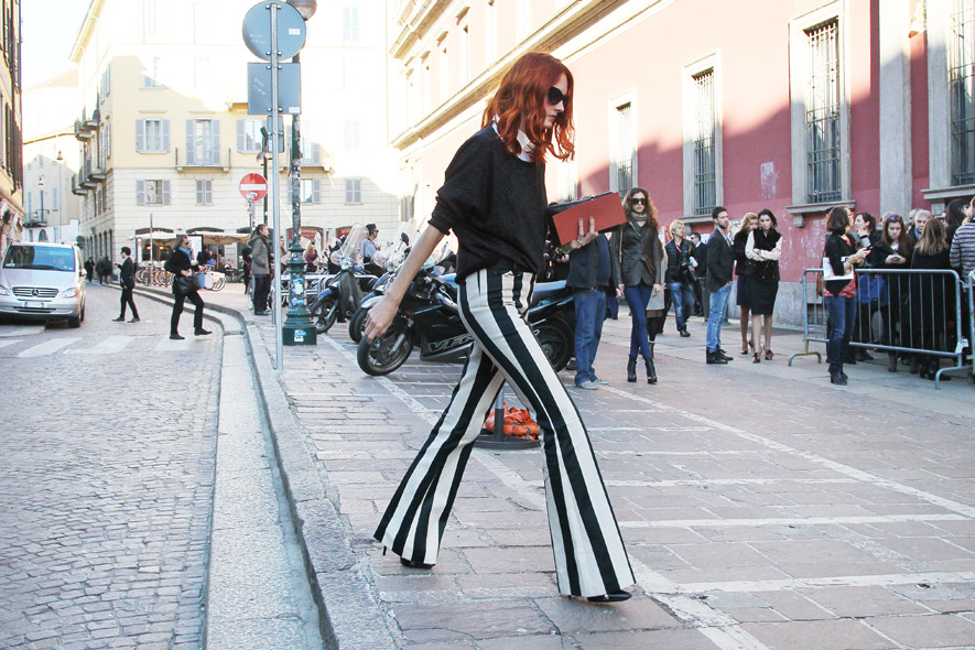 Taylor Tomasi Hill in black and white striped Celine pants. Image: grazia.it