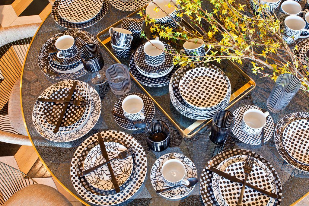 Still life of four graphic Kelly Wearstler dinnerware settings.