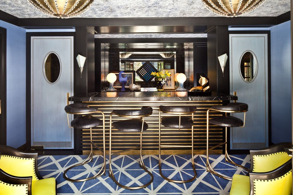 Soulful periwinkle bar sparkles with its many metal details and citron chairs.
