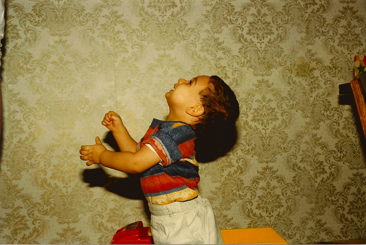 1998 Russia my dad took this picture of me! playing with the wall? maybe.