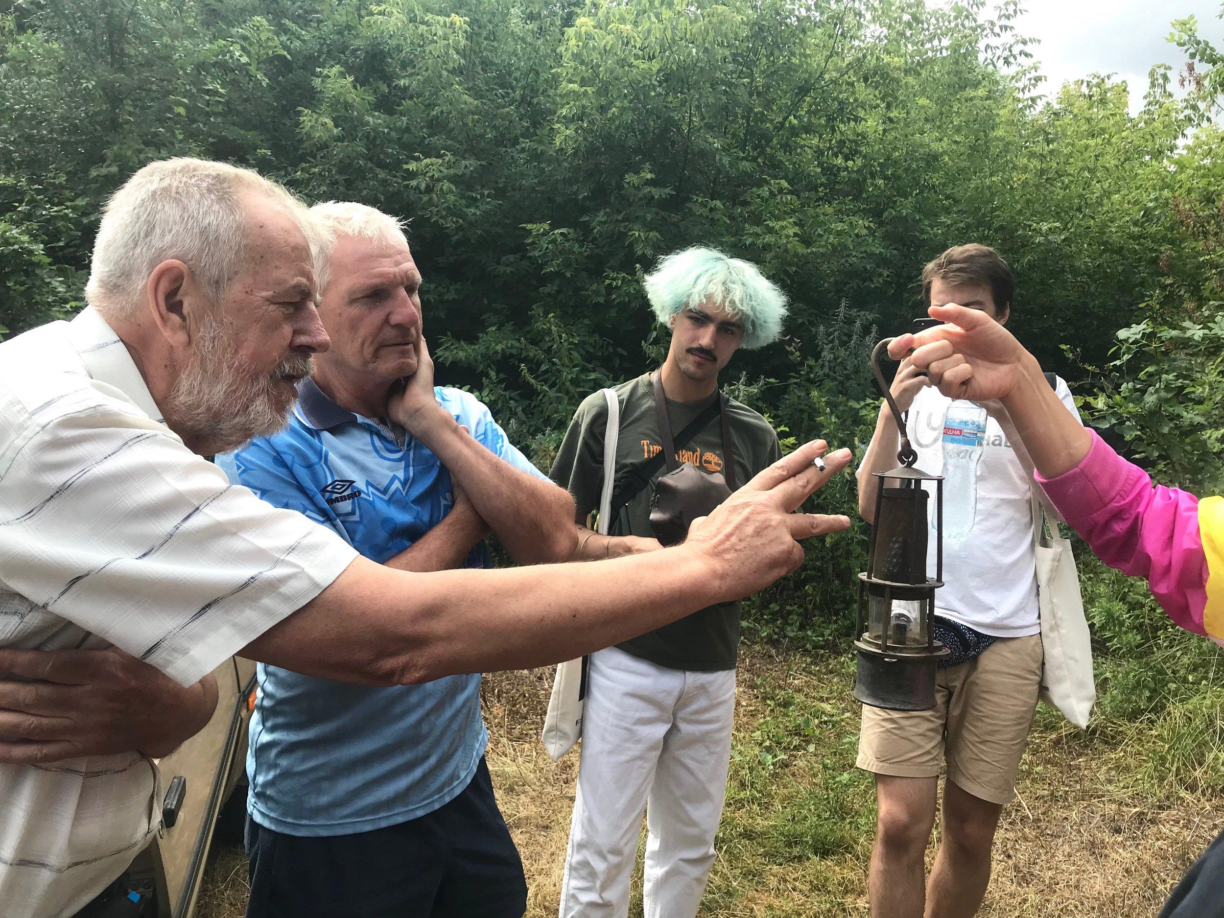 Local Historian Dr. Mykola Lomako and guide Nikola Skuridin show 19th c. mining equipment