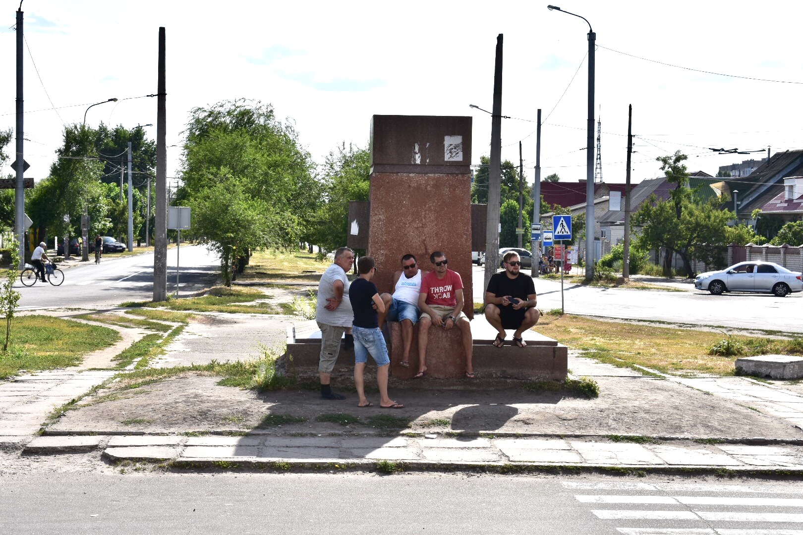 """""""The New Lenins!"""" Local townspeople of Lysychansk relax near the pedestal to the removed statue of Lenin, Central Bus Station, Severodonetsk"""