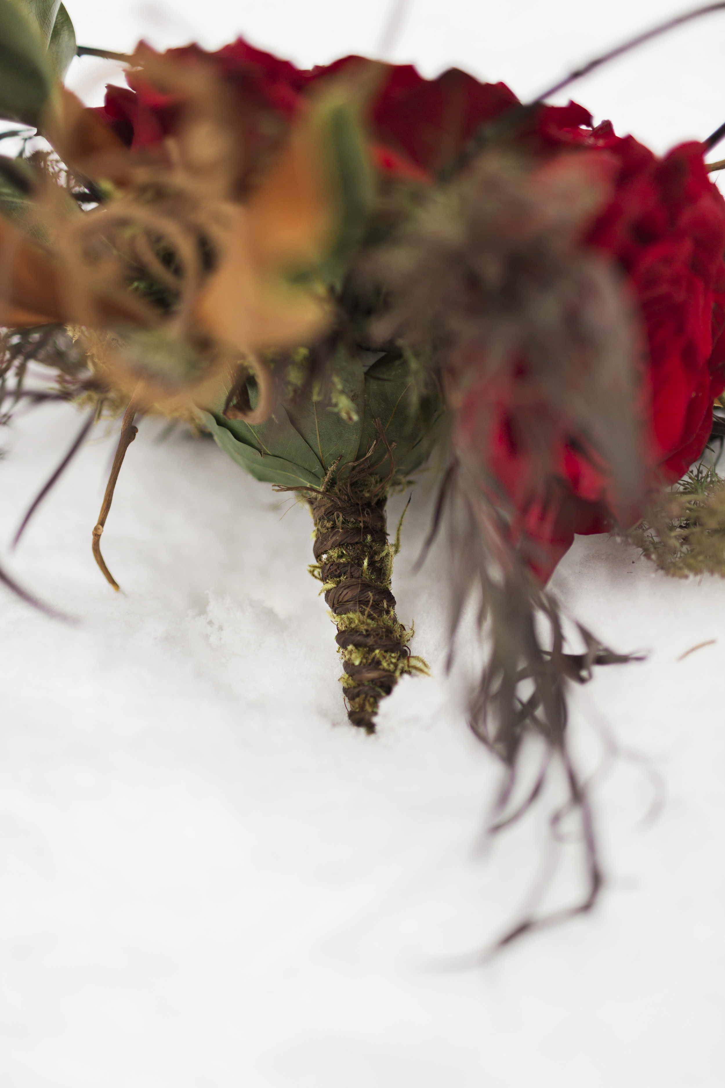 Mossy details on the bouquet handle.
