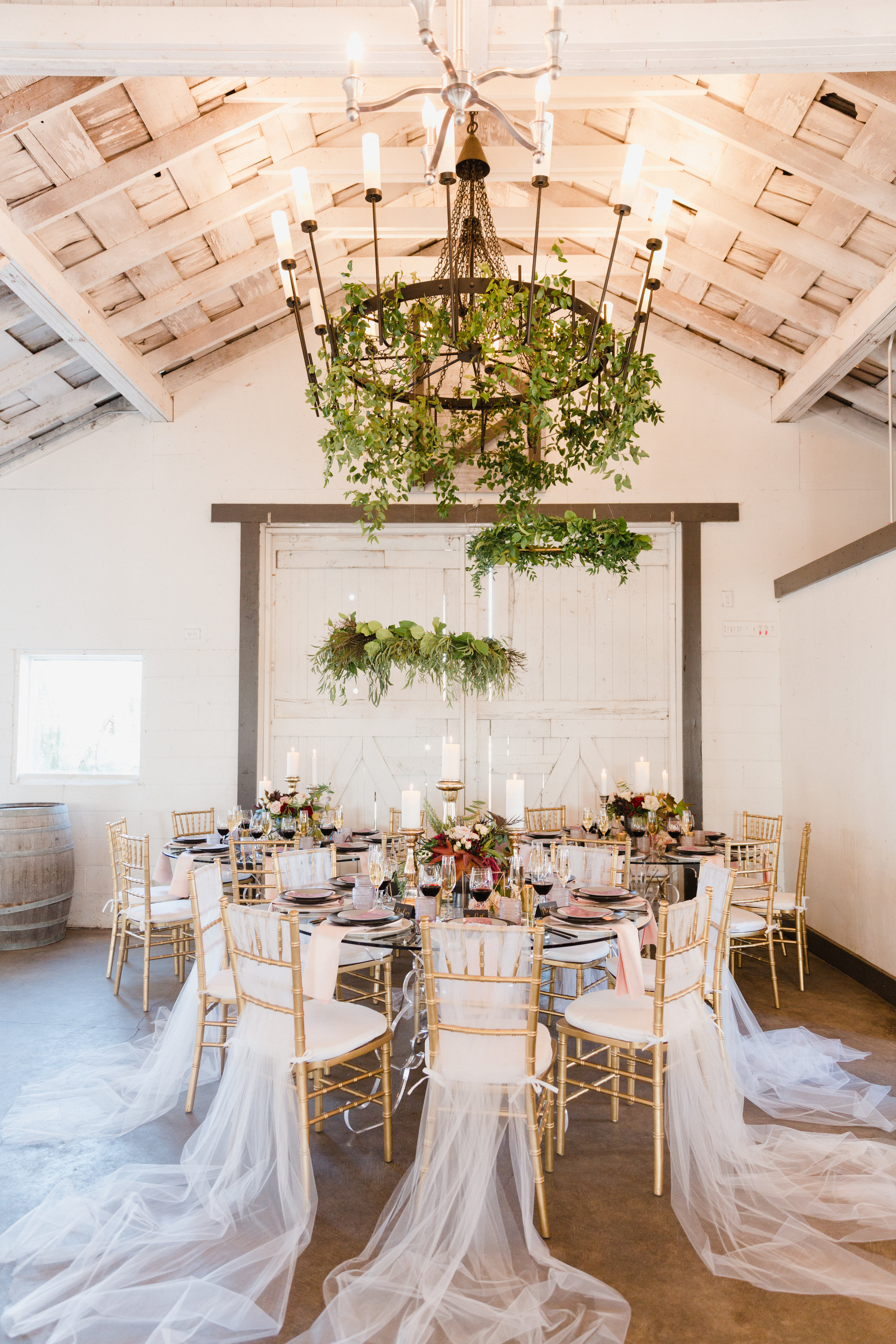 Hanging greenery chandeliers around the reception tables at Dairyland. From the Ground Up Floral - Seattle Florist.