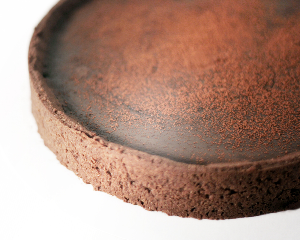 salted-caramel chocolate tart - Chocolate tart crustSalted caramel layerDark chocolate ganacheCocoa powder dust8