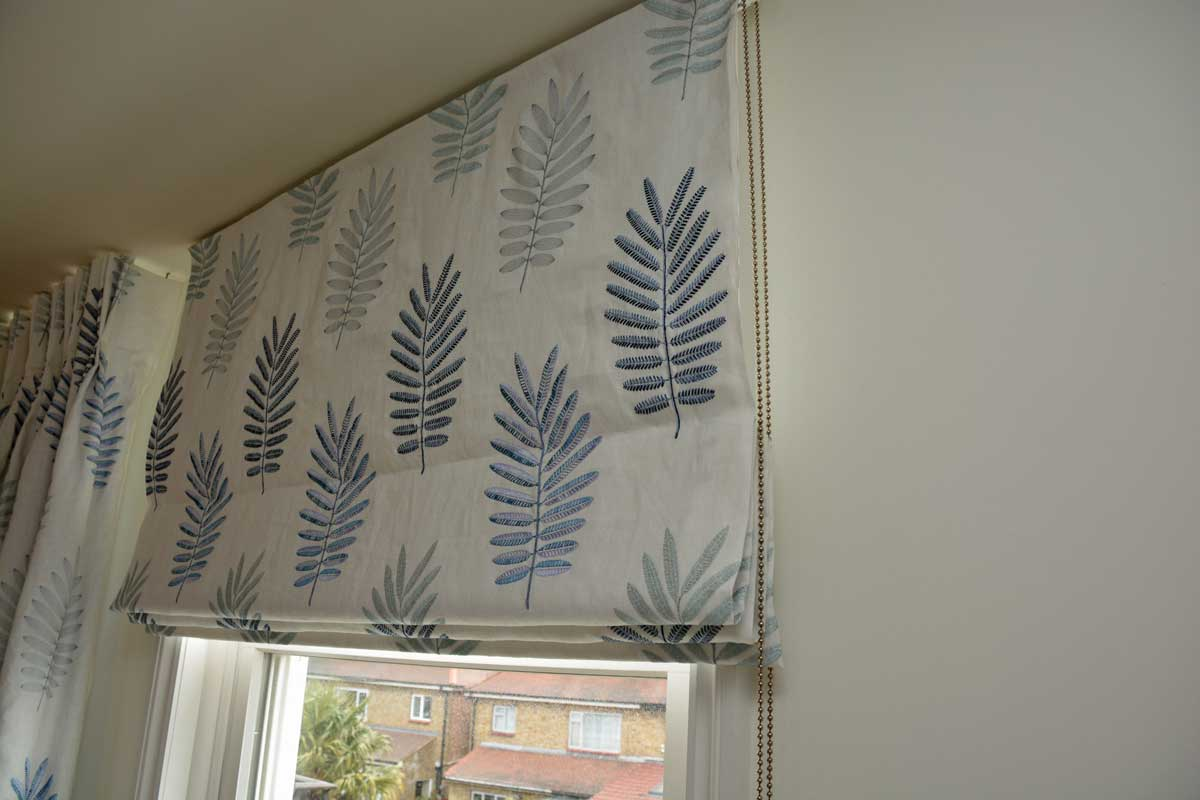 Roman blind with blue/grey leaf print fabric