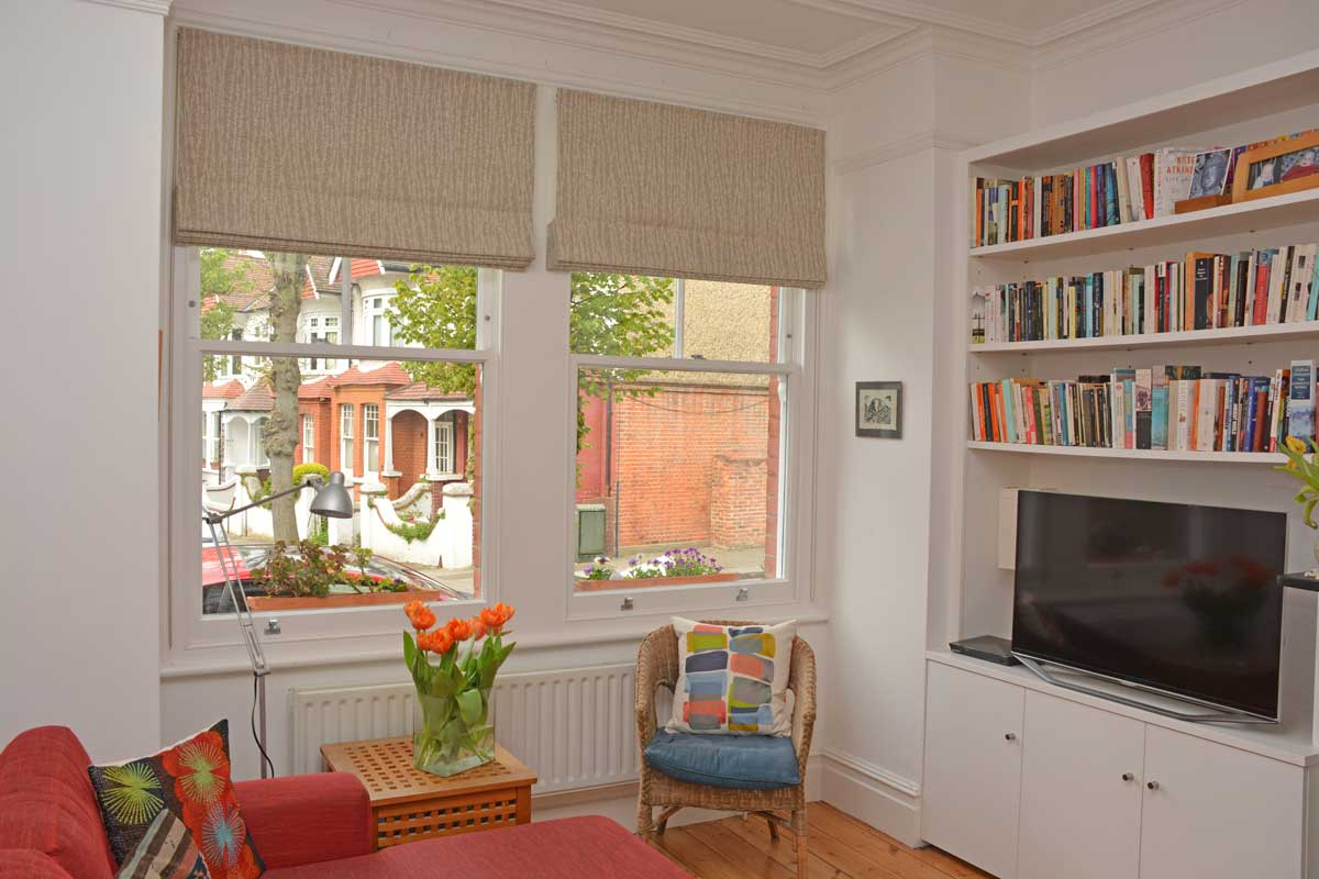 Double roman blind in a stone-grey fabric