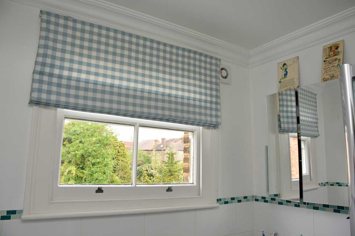 Roman blind with blue chequered fabric
