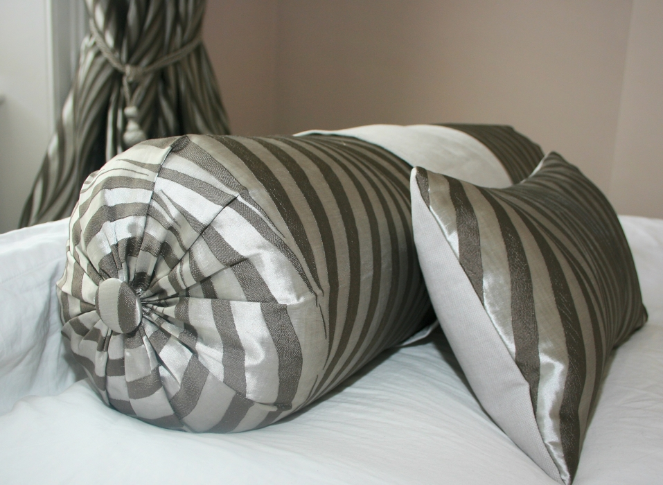 Bolster cushion and small rectangular cushion, with matching curtains